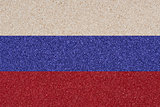 Russian flag made ​​of colored decorative sand.