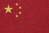 China flag made of colored decorative sand.