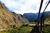 Peruvian train and ancient buildings