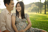 asian chinese romantic couple in the park during sunrise