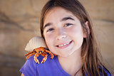 Young Girl Playing with Toy Hermit Crab