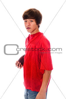 Young teen football boy on white