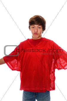 Young teen boy in red jersey isolated on white