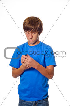 Young teen boy looking at cell phone