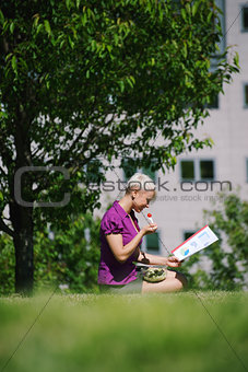 lunch break with business person eating vegetable in park