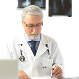 Doctor writing a prescription, on the white background with x-rays