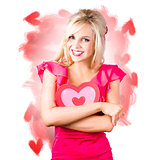 Smiling romantic blond female hugging love heart