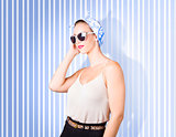 Glamour fashion girl on retro striped background