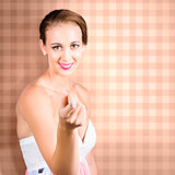 Cute brunette girl pointing with laundry peg