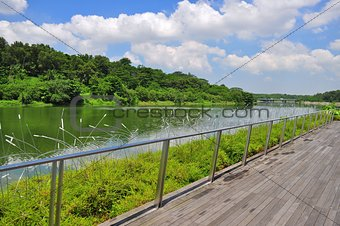 A wooden walkway by the river at Punggol Waterway