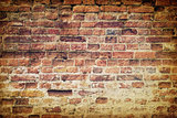Vintage old weathered brick wall
