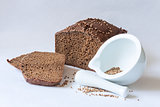 traditional Russian black bread with coriander seeds with mortar