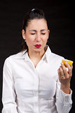 woman eat yellow lemon