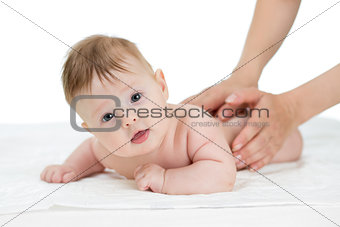 baby getting massage studio shot on white background
