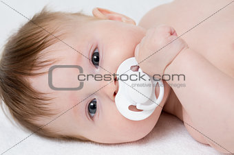 baby with pacifier closeup portrait