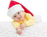 Baby girl in Santa's hat on white background