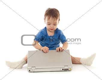 Toddler is using notebook isolated on white
