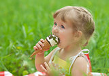 little girl eating ice cream outdoor