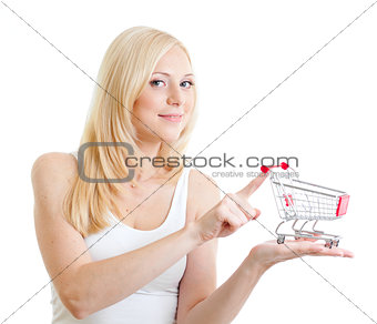 Blond girl wearing  white tank top with small shopping cart in