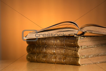 old grunge books on wooden table with free space for your text