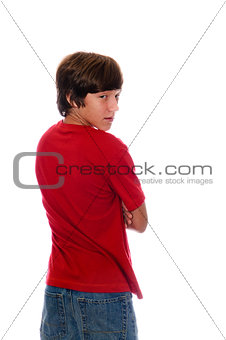 Young teen boy looking backward on white