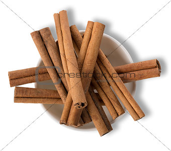 Cinnamon in plate isolated