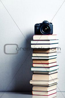 Camera on a high stack of books
