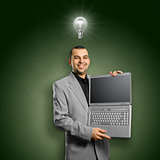 Idea Concept businessman with open laptop in his hands