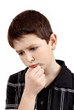 pensive young boy isolated on white background