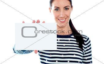 Beautiful girl holding blank card. Copyspace