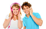 Couple enjoying music through headphones