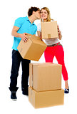 Young couple gently holding cartons