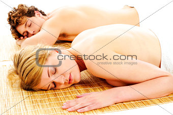 Attractive young couple at spa
