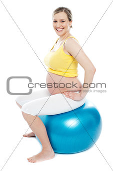 Pregnant woman exercises with gymnastic ball