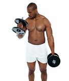 Young african man doing biceps exercise