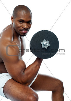 Portrait of happy fit african man working out