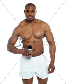 Athlete posing with health drink bottle