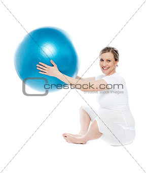 Pregnant woman playing with exercise ball