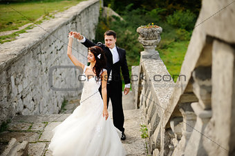 young wedding couple next to castle