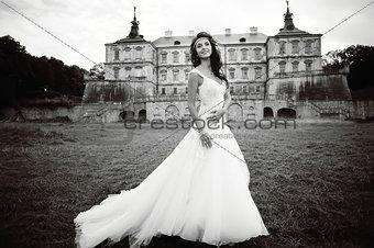 Caucasian young bride next to castle in west Ukraine