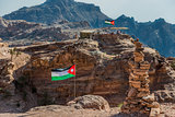 jordan flags floating in nabatean city of  petra