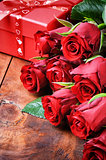 Bouquet of red roses and gift box