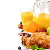 Breakfast with orange juice and fresh croissants