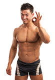 Muscular man showing ok sign isolated over white