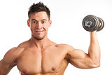 Muscular man lifting a dumbbell over white
