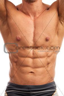 Torso of bodybuilder over white