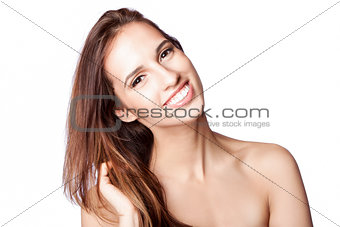 Happy woman touching hair