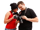 Photographer and model looking at photos