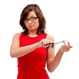 Young woman cutting nail