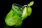 cocktail with lime and mint closeup